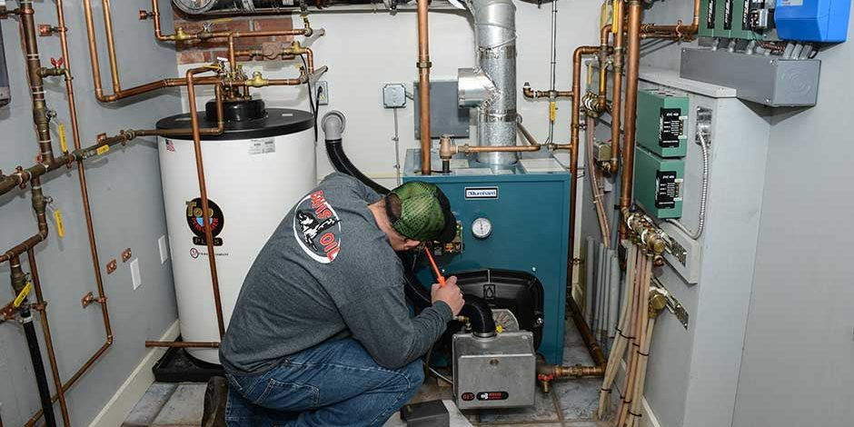 Davis Oil Employee fixing a furance