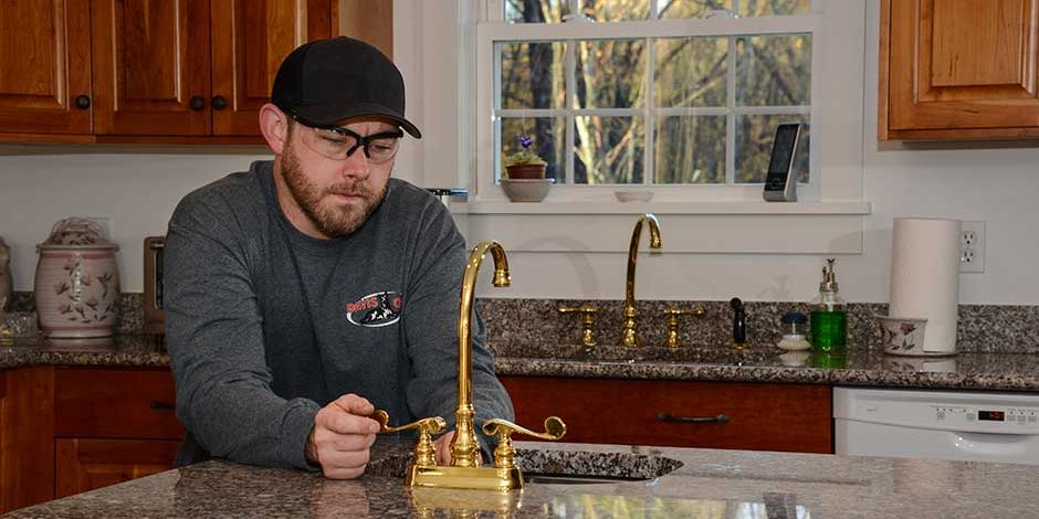 NH master plumber installing and servicing a sink faucet