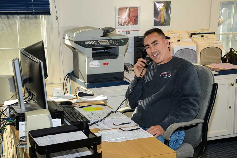 Steve Walsh at his desk, on the phone with a customer.