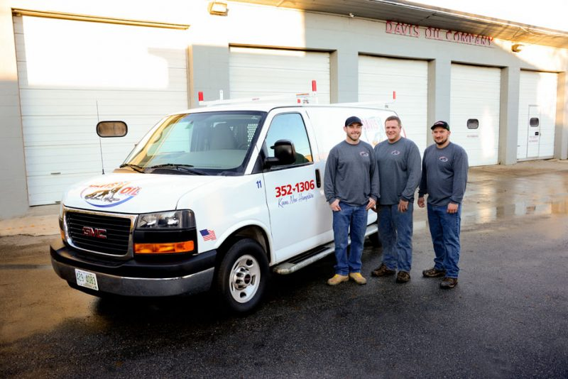 Three Davis Oil employees standing in front of one of their service vans